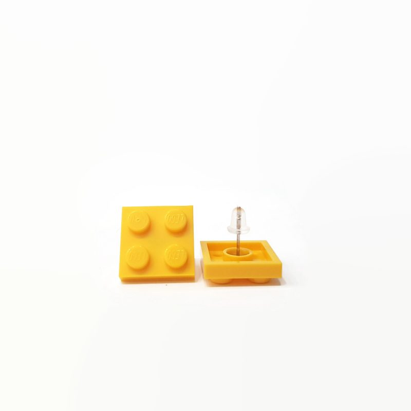 Yellow earrings made from lego bricks
